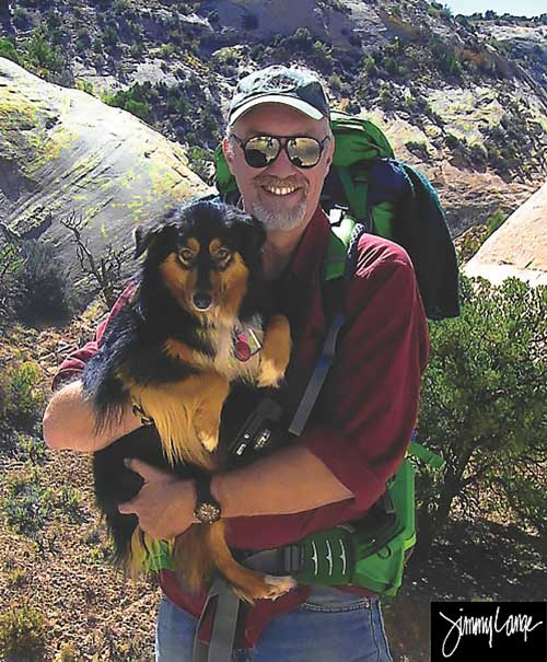 Photo of artist and author Jimmy Lange with his dog Penny